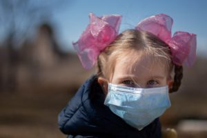 A child in a medical mask during a coronavirus pandemic